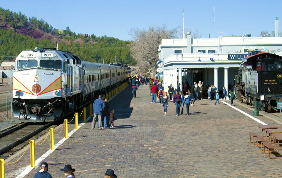 Photo - This photo provided by Grand Canyon Railway shows the train at its depot in Williams, Arizona. The train runs daily round-trip to the Grand Canyon's South Rim. The railway has been running since 1901, carries 225,000 people a year and offers history, sightseeing, scenery and entertainment. (AP Photo/Grand Canyon Railway)