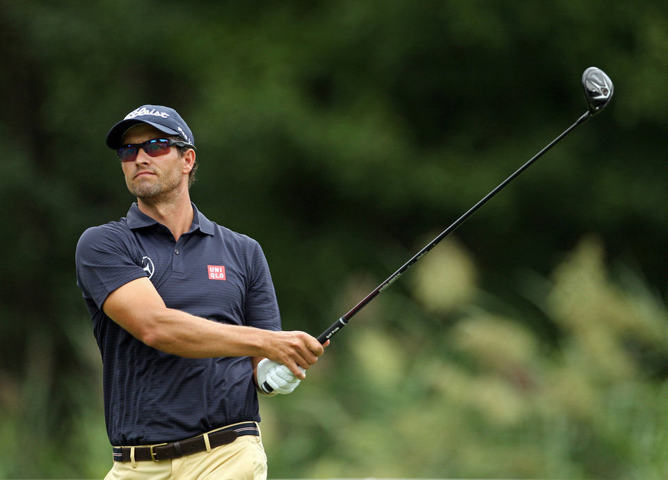 Photo - Adam Scott, of Australia, watches his tee shot on the fifth hole during second round play at The Barclays golf tournament Friday, Aug. 22, 2014, in Paramus, N.J. (AP Photo/Adam Hunger)