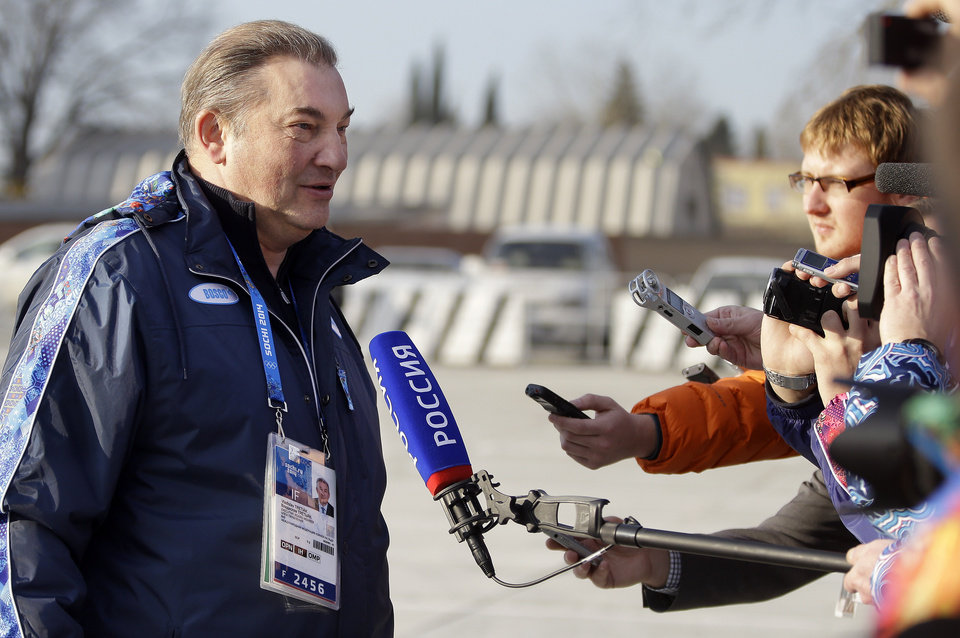 Photo - Vladislav Tretiak, a former goaltender for Russia's national ice hockey team, talks with reporters at the Sochi International Airport where NHL hockey players are arriving for the 2014 Winter Olympics, Monday, Feb. 10, 2014, in Sochi, Russia. (AP Photo/Mark Humphrey)