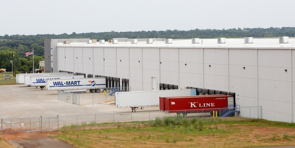 Photo -  Trailers line the docks at ShurTech Brands' distribution center at 8301 N Interstate 35. Dallas-based Sealy & Co. paid $17 million for the 280,000-square-foot warehouse, developed by Richard Tanenbaum, who is now building a 125,000-square-foot speculative warehouse a mile north at I-35 and Hefner Road, where he built ShurTech's first center here in 2000. PHOTO BY PAUL B. SOUTHERLAND   PAUL B. SOUTHERLAND