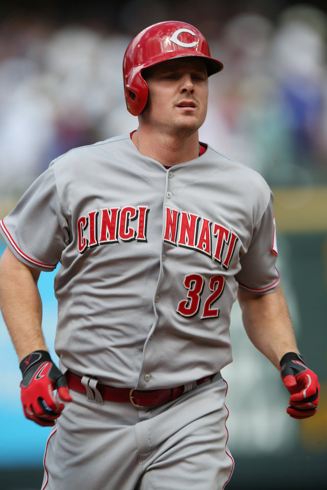 Photo - Cincinnati Reds' Jay Bruce circles bases after hitting a two-run home run against the Colorado Rockies in the fourth inning of a baseball game in Denver, Sunday, Aug. 17, 2014. (AP Photo/David Zalubowski)