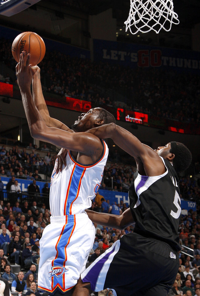 Oklahoma City's Kevin Durant (35) is fouled by Sacramento's John Salmons (5)  during an NBA basketball game between the Oklahoma City Thunder and the Sacramento Kings at Chesapeake Energy Arena in Oklahoma City, Friday, Dec. 14, 2012. Photo by Bryan Terry, The Oklahoman