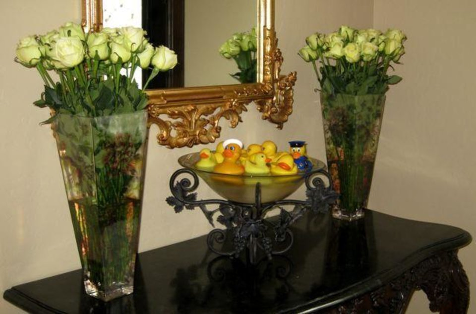 SIP AND SEE...Yellow ducks floated in vases for the party and baby shower honoring baby Cole Kramedjian. (Photo by Helen Ford Wallace).