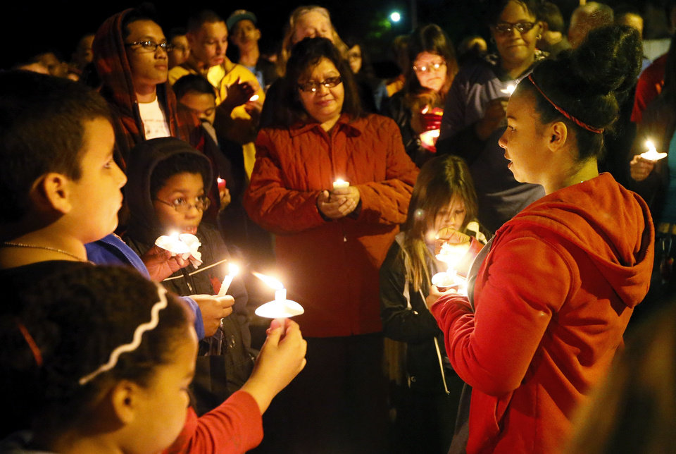 Katon Johnson, sister of Kittrick Johnson Jr., talks about her brother Wednesday during a candlelight vigil in  Midwest City.  Photo by  Nate Billings,  The Oklahoman