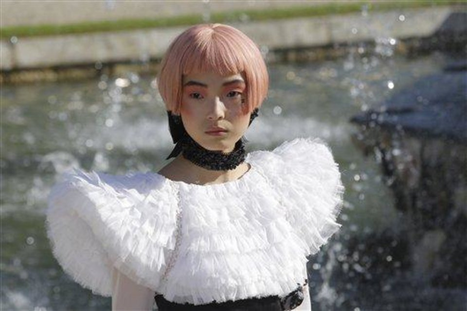A model presents a creation by German fashion designer Karl lagerfeld for Chanel Monday, May, 14, 2012. Master of Fashion, Karl Lagerfeld spares no expenses for his midseason Chanel Cruise show offering held at the former home of Marie Antoinette, the Chateau de Versailles, southwest of Paris. (AP Photo/Jacques Brinon)