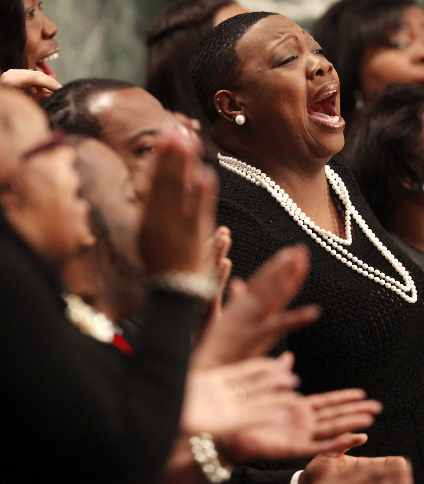 Members of the Malcom Williams & Great Faith Gospel singing group, including Tiffany Collier, sing during a Martin Luther King Day tribute event in the Rotunda of the Wisconsin state Capitol building in Madison, Wis. on  Monday, Jan. 21, 2013. (AP Photo/Wisconsin State Journal, John Hart)