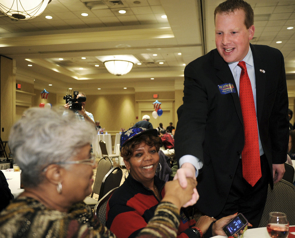 Jason Plummer, right, Republican candidate for Illinois' 12th Congressional District, talks with supporters Phyllis Hopkins, left, and Toni Perrin during a post-election party at the Four Seasons Sheraton on Election Day, Tuesday, Nov. 6, 2012, in Fairview Heights, Ill. (AP Photo/St. Louis Post-Dispatch, Sid Hastings) EDWARDSVILLE INTELLIGENCER OUT; THE ALTON TELEGRAPH OUT