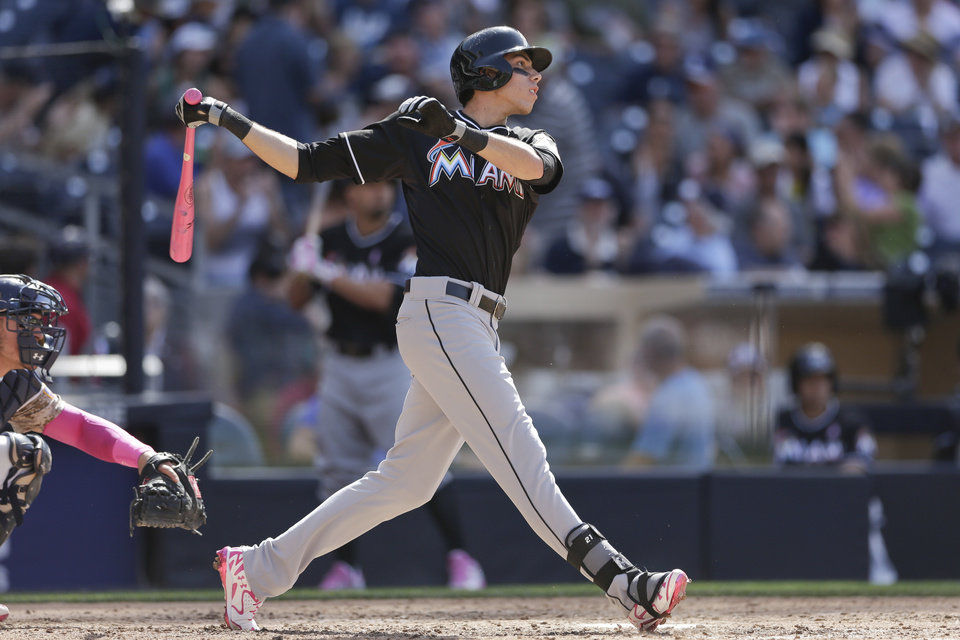 Photo - Miami Marlins' Christian Yelich watches his solo home run while playing the San Diego Padres during the eighth inning of a baseball game Sunday, May 11, 2014, in San Diego. (AP Photo/Gregory Bull)