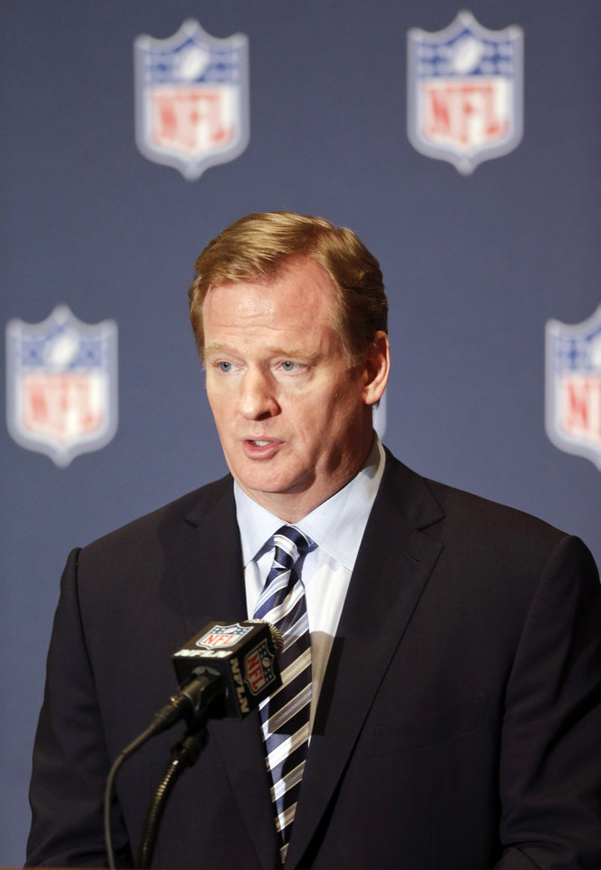 Photo - NFL Commissioner Roger Goodell voices support to help grow youth football during a news conference at the NFL annual meeting in Orlando, Fla., Monday, March 24, 2014. (AP Photo/John Raoux)