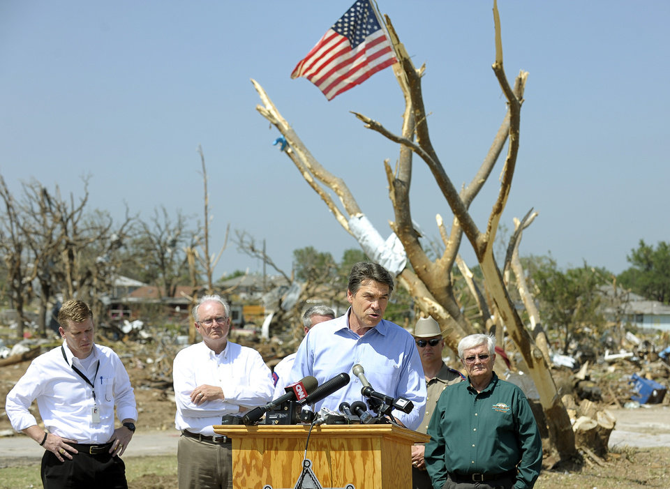 Photo - Texas Gov. Rick Perry, center, speaks to the media during a tour of storm damaged areas in Granbury, Texas, on Friday May 17, 2013. On Wednesday, powerful storms produced 16 tornadoes in the area that left six people dead. (AP Photo/The Fort Worth Star-Telegram, Max Faulkner)  MAGS OUT; (FORT WORTH WEEKLY, 360 WEST); INTERNET OUT