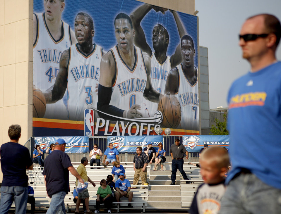 Photo - Fans gather outside the Oklahoma City Arena before the NBA basketball game between the Denver Nuggets and the Oklahoma City Thunder in the first round of the NBA playoffs at the Oklahoma City Arena, Sunday, April 17, 2011. Photo by Bryan Terry, The Oklahoman