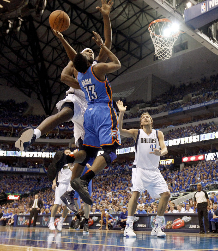 Photo - Oklahoma City's James Harden (13) is fouled by Brendan Haywood (33) of Dallas as Dirk Nowitzki (41) watches during game 5 of the Western Conference Finals in the NBA basketball playoffs between the Dallas Mavericks and the Oklahoma City Thunder at American Airlines Center in Dallas, Wednesday, May 25, 2011. Photo by Bryan Terry, The Oklahoman