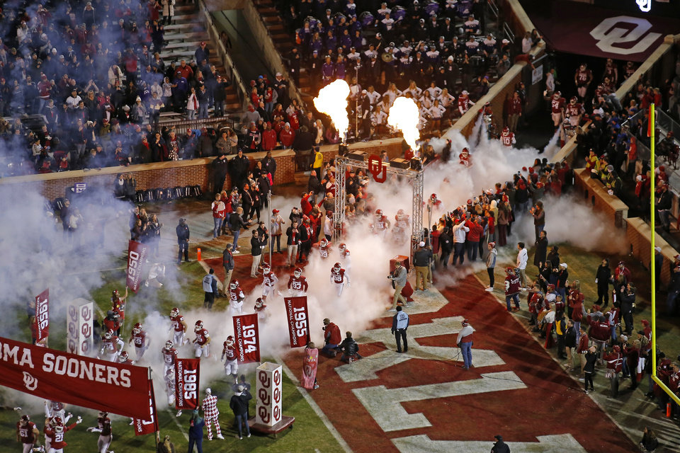 Photo - Oklahoma takes the field before an NCAA football game between the University of Oklahoma Sooners (OU) and the TCU Horned Frogs at Gaylord Family-Oklahoma Memorial Stadium in Norman, Okla., Saturday, Nov. 23, 2019. Oklahoma won 28-24. [Bryan Terry/The Oklahoman]