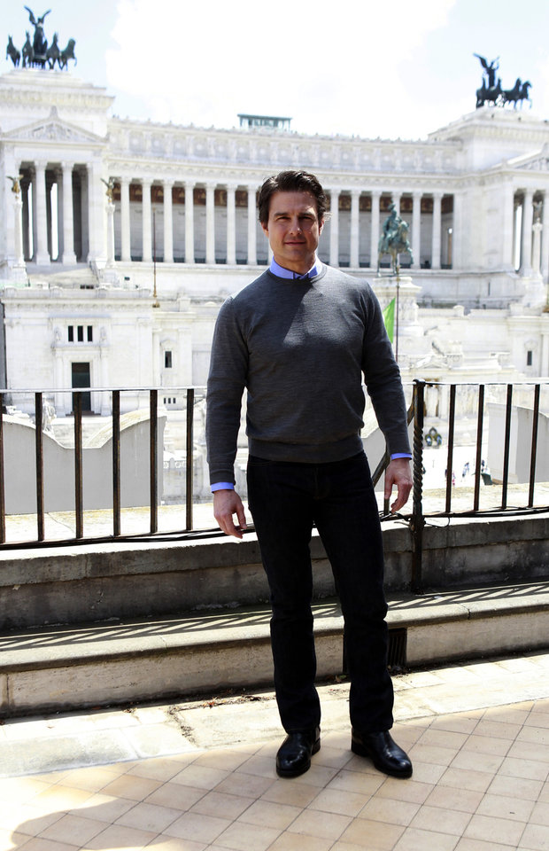 Photo - U.S. actor Tom Cruise poses to photographers, with the monument of the Unknown Soldier in the background, during a photocall for his new film 'Edge of Tomorrow' in Rome, Tuesday, May 27, 2014. (AP Photo/Isabella Bonotto)