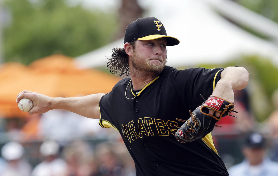 Photo - Pittsburgh Pirates starting pitcher Gerrit Cole throws during the first inning of a spring exhibition baseball game against the Baltimore Orioles in Sarasota, Fla., Sunday, March 23, 2014. (AP Photo/Carlos Osorio)