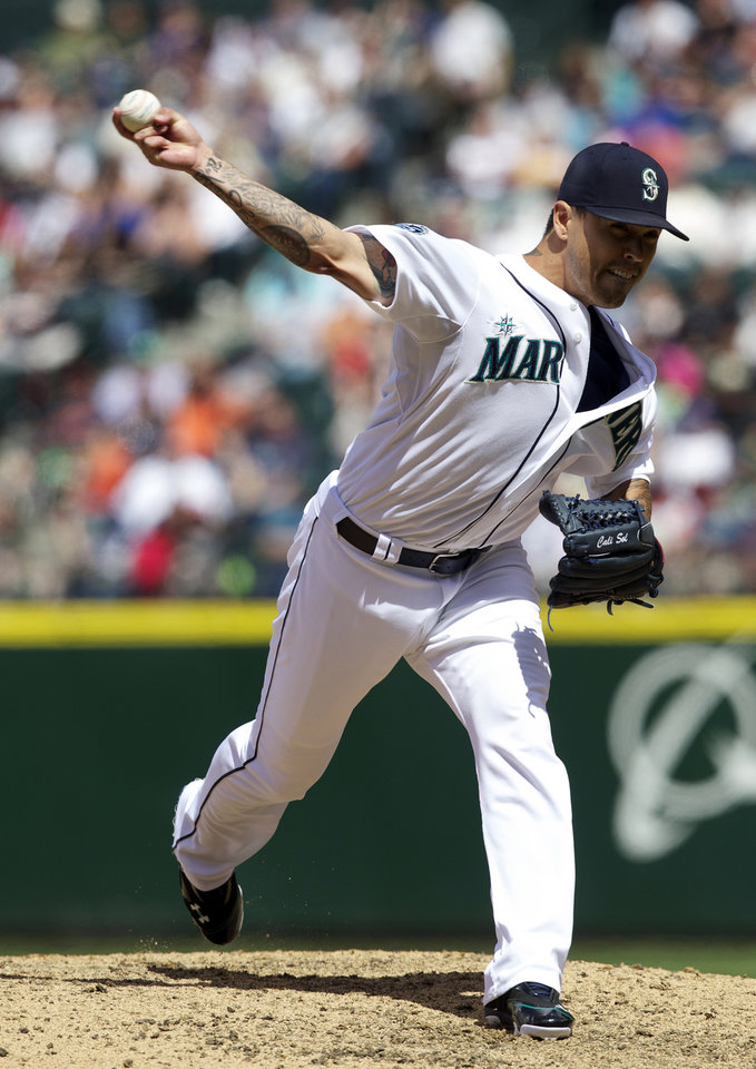 Photo -   Seattle Mariners reliever Brandon League delivers in the eighth inning of a baseball game against the San Francisco Giants at Safeco Field in Seattle, Sunday, June 17, 2012. The Mariners won 2-1. (AP Photo/Stephen Brashear)