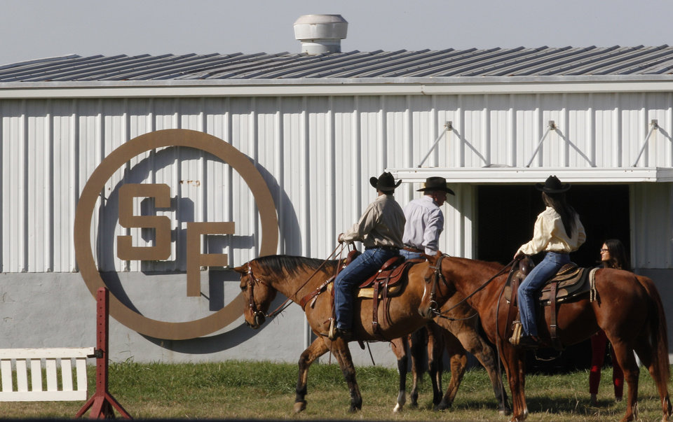 "In this photo made Tuesday, Nov. 13, 2012, stunt riders prepare to shoot a scene for the TV show Dallas at Southfork Ranch in Parker, Texas. Tourists have been flocking to Southfork Ranch since the early years of the classic series, which ran from 1978 to 1991. And a new ""Dallas"" starting its second season on TNT on Monday and the recent death of the show\'s star, Larry Hagman, who legendarily played conniving Texas oilman J.R. Ewing, have also spurred fans to visit. (AP Photo/LM Otero)"