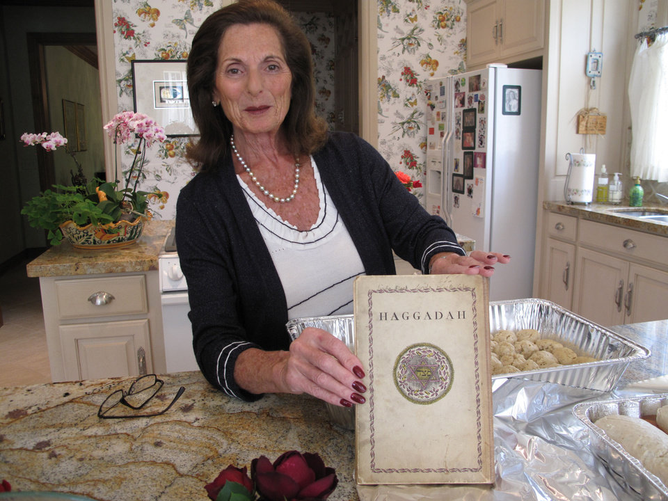 Photo - Linda Gardner of Oklahoma City displays a vintage Passover Haggadah that she was given as a school award at age 8. Gardner, 77, said her haggadah was published in 1946.Photo by CARLA HINTON, The Oklahoman