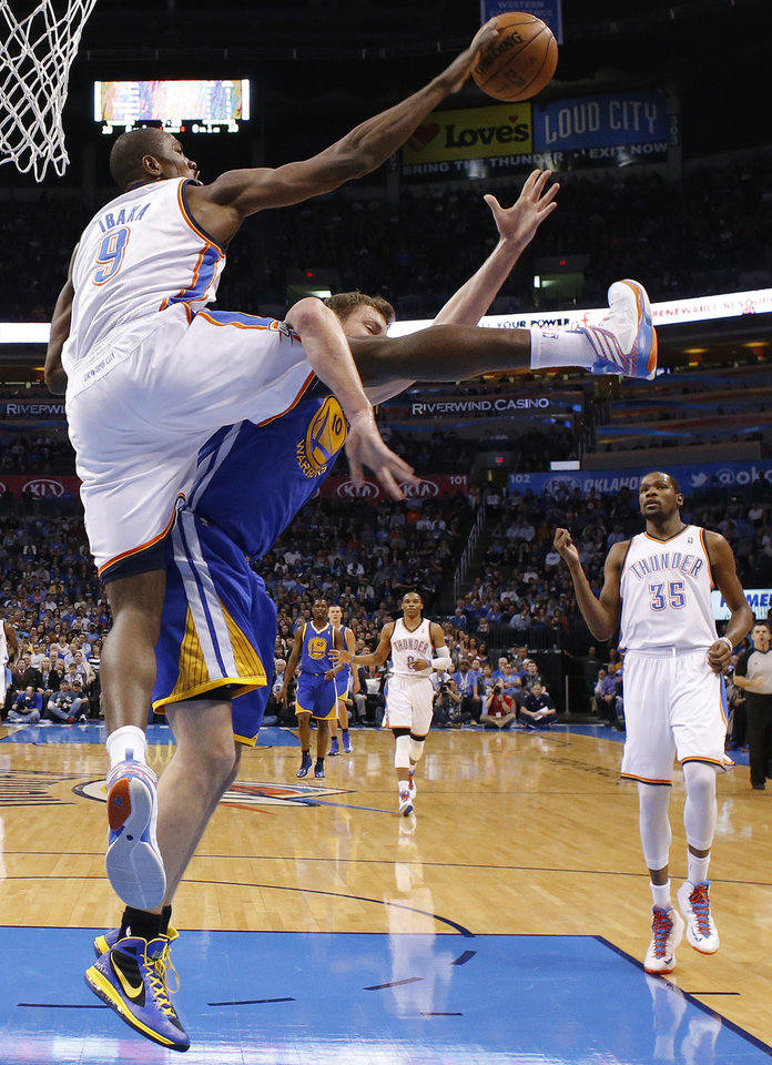 Oklahoma City's Serge Ibaka (9) blocks the shot of Golden State's David Lee (10) during an NBA basketball game between the Oklahoma City Thunder and the Golden State Warriors at Chesapeake Energy Arena in Oklahoma City, Wednesday, Feb. 6, 2013. Photo by Bryan Terry, The Oklahoman
