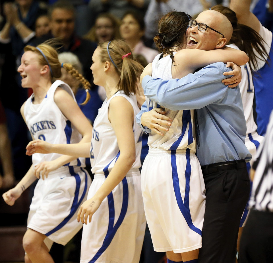 Photo - Mount St. Mary head coach Rory Hamilton hugs Kaely Bond (21) as the team celebrate's its win over Byng in a Class 4A girls high school basketball game in the first round of the state tournament at the Sawyer Center on the campus of Southern Nazarene University in Bethany, Okla., Thursday, March 7, 2013. Mount St. Mary won, 51-37. Photo by Nate Billings, The Oklahoman