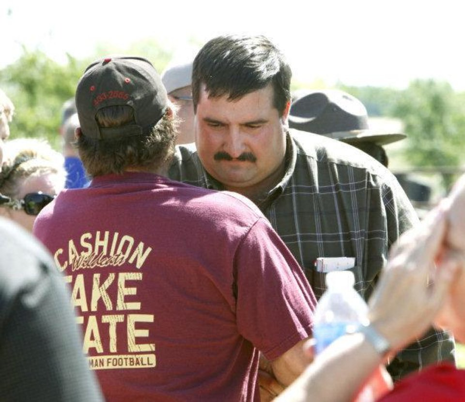 TORNADO / DEATH / CHILD / RECOVERY: Hank Hamil is comforted by a neighbor after hearing the news that the body of his missing three-year-old son Ryan Hamil had been found and recovered in Piedmont, OK, Thursday, May 26, 2011. Ryan has been missing since a tornado struck his family\'s home on Tuesday, May 24, 2011.By Paul Hellstern, The Oklahoman ORG XMIT: KOD