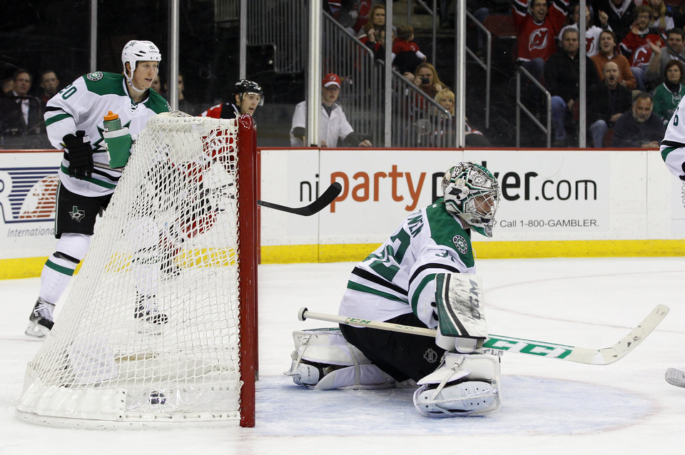 Photo - Dallas Stars goalie Kari Lehtonen, of Finland,  gives up a goal to New Jersey Devils right wing Michael Ryder during the second period of an NHL hockey game Thursday, Jan. 9, 2014, in Newark, N.J. (AP Photo/Adam Hunger)