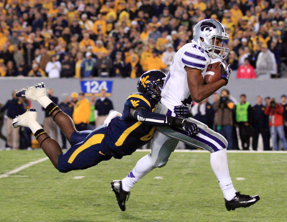 Photo -   Kansas State's Tyler Lockett (16) is brought down by West Virginia's Karl Joseph during the second quarter of an NCAA college football game in Morgantown, W.Va., Saturday, Oct. 20, 2012. (AP Photo/Christopher Jackson)