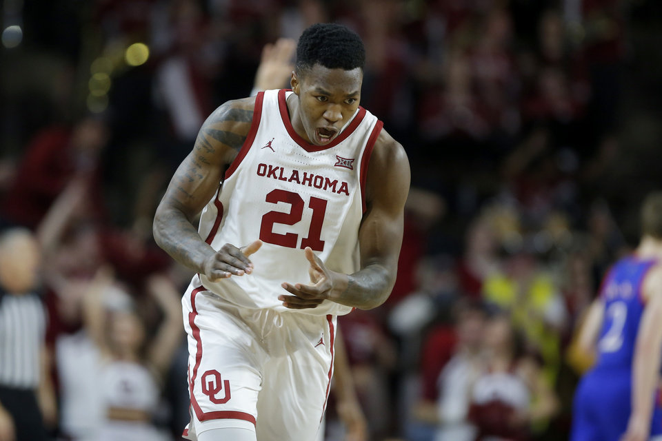 Photo - Oklahoma's Kristian Doolittle (21) celebrates during an NCAA college basketball game between the University of Oklahoma Sooners (OU) and the University of Kansas Jayhawks at Lloyd Noble Center in Norman, Okla., Tuesday, Jan. 14, 2020. [Bryan Terry/The Oklahoman]