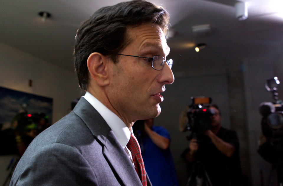 Photo - House Majority Leader Eric Cantor of Va., walks out of a Republican caucus at the U.S. Capitol in Washington, Saturday, Sept. 28, 2013.  Lawmakers from both parties urged one another in a rare weekend session to give ground in their fight over preventing a federal shutdown, with the midnight Monday deadline fast approaching. (AP Photo/Molly Riley)