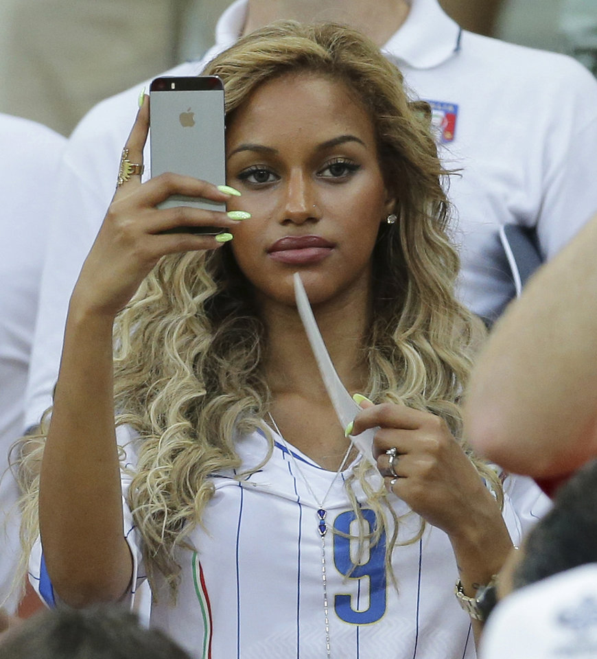 Photo - Belgian Fanny Neguesha, Mario Balotelli's girlfriend, attends at the group D World Cup soccer match between England and Italy at the Arena da Amazonia in Manaus, Brazil, Saturday, June 14, 2014. (AP Photo/Antonio Calanni)
