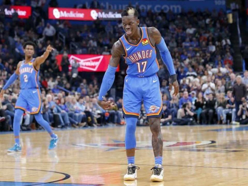 Photo -  Oklahoma City's Dennis Schroder celebrates a basket during Friday night's game against the Phoenix Suns at Chesapeake Energy Arena. Schroder scored 24 points in the Thunder's 126-108 victory. [Sarah Phipps/The Oklahoman]