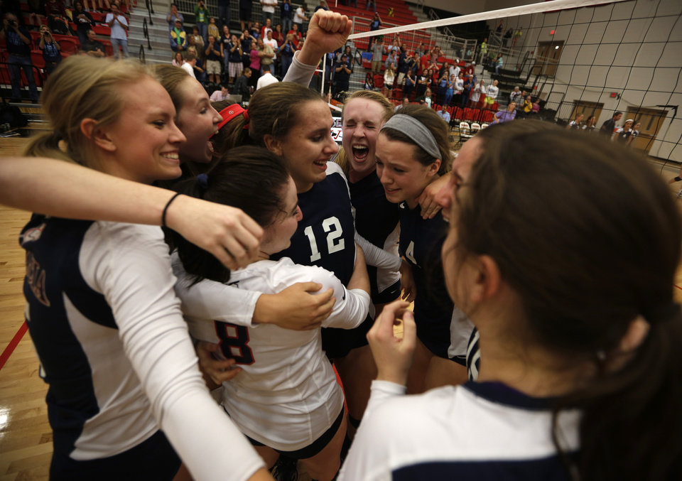 Cascia Hall celebrates after winning the OSSAA 5A State Volleyball Championship between Cascia Hall and Heritage Hall at Westmoore High School in Moore, Okla., Saturday, Oct. 13, 2012. Photo by Garett Fisbeck, The Oklahoman