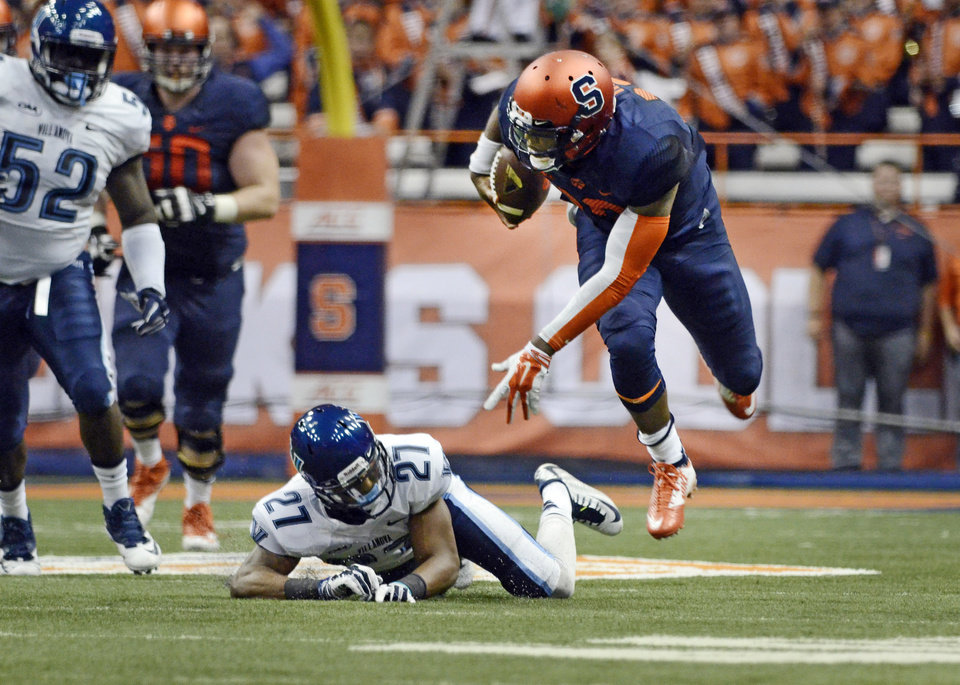 Photo - Syracuse Terrel Hunt, right, goes flying after being tripped by Villanova's Malik Reaves during an NCAA college football game at the Carrier Dome, Friday, Aug. 29, 2014 in Syracuse, N.Y. (AP Photo/Heather Ainsworth)