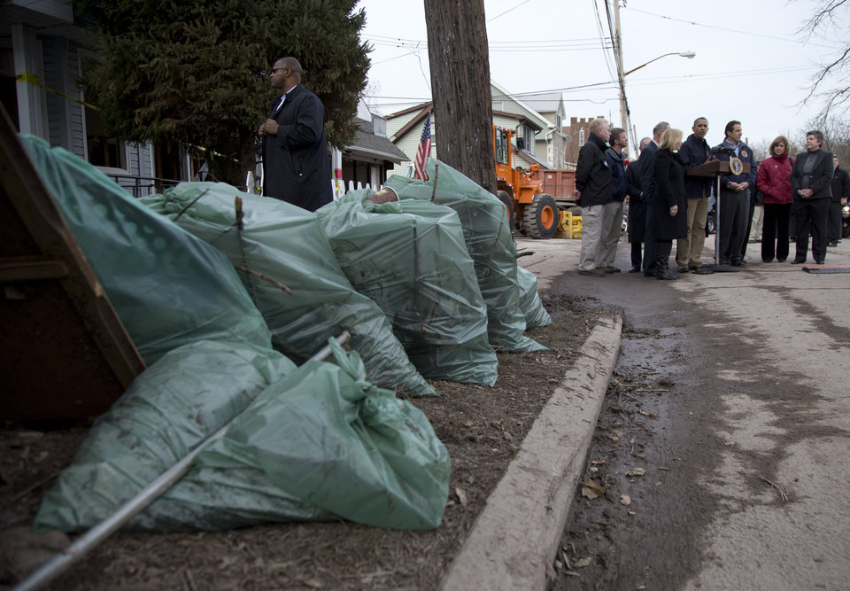 Photo -  President Barack Obama talks to press on Cedar Grove Avenue, a street significantly impacted by Superstorm Sandy, Thursday, Nov. 15, 2012, on Staten Island, in New York. (AP Photo/Carolyn Kaster)