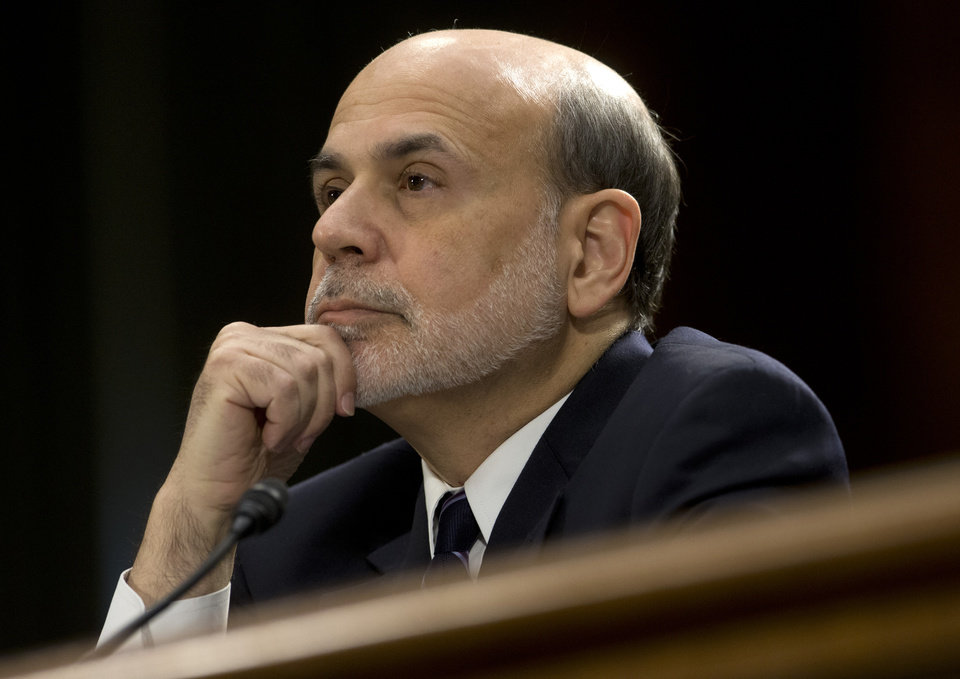 Federal Reserve Board Chairman Ben Bernanke pauses before testifying on Capitol Hill in Washington, Tuesday, Feb. 26, 2013, before the Senate Banking Committee hearing to deliver the central bank's Semiannual Monetary Policy Report to the Congress. (AP Photo/Carolyn Kaster)
