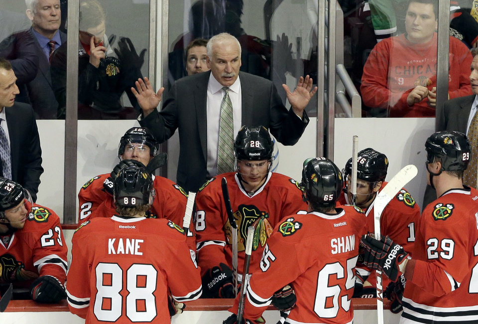 Photo - Chicago Blackhawks head coach Joel Quenneville, top, talks to his team during the third period of an NHL hockey game against the Nashville Predators in Chicago, Friday, March 14, 2014. The Predators won 3-2. (AP Photo/Nam Y. Huh)