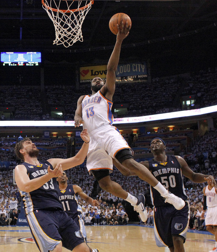 Oklahoma City\'s James Harden (13) goes between Marc Gasol (33) and Zach Randolph (50) of Memphis during game five of the Western Conference semifinals between the Memphis Grizzlies and the Oklahoma City Thunder in the NBA basketball playoffs at Oklahoma City Arena in Oklahoma City, Wednesday, May 11, 2011. Photo by Bryan Terry, The Oklahoman
