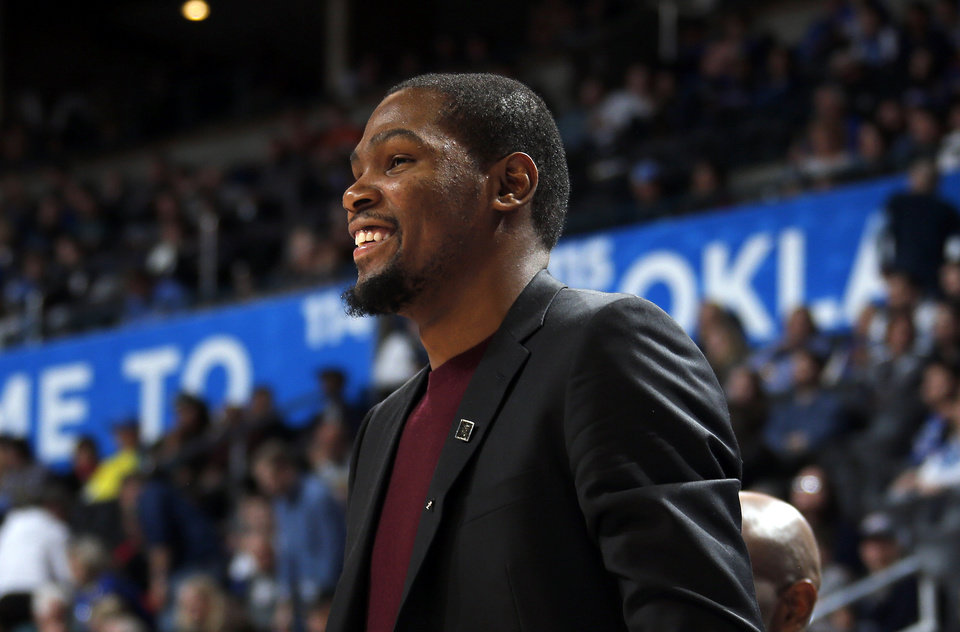 Photo - Oklahoma City's Kevin Durant (35) cheers from the bench during the NBA basketball game between the Oklahoma City Thunder and the Charlotte Hornets at the Chesapeake Energy Arena in Oklahoma City, Friday, Dec. 26, 2014. Photo by Sarah Phipps, The Oklahoman