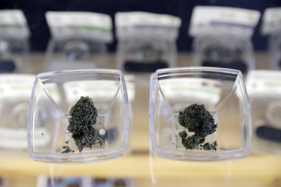 Photo - File: Cannabis flowers are displayed for sale at the Berkeley Patients Group dispensary Wednesday, Feb. 14, 2018, in Berkeley, Calif. Oklahoma lawmakers are considering restrictions ahead of the statewide vote to legalize medical marijuana in June. (AP Photo/Marcio Jose Sanchez)
