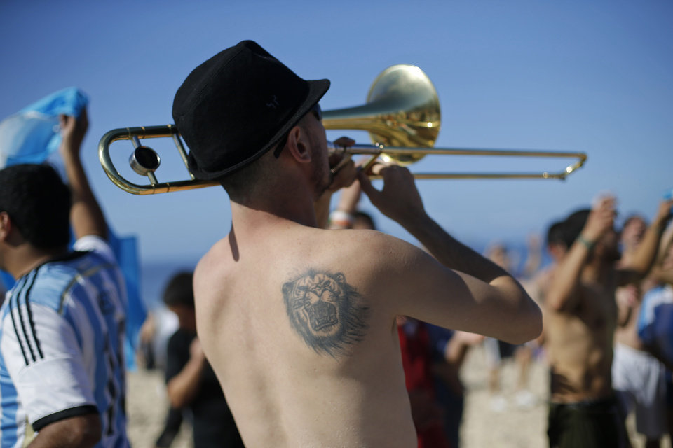 Photo - An Argentina soccer fan plays the trumpet on Copacabana beach before the final World Cup match between Argentina and Germany in Rio de Janeiro, Brazil, Sunday, July 13, 2014. (AP Photo/Silvia Izquierdo)