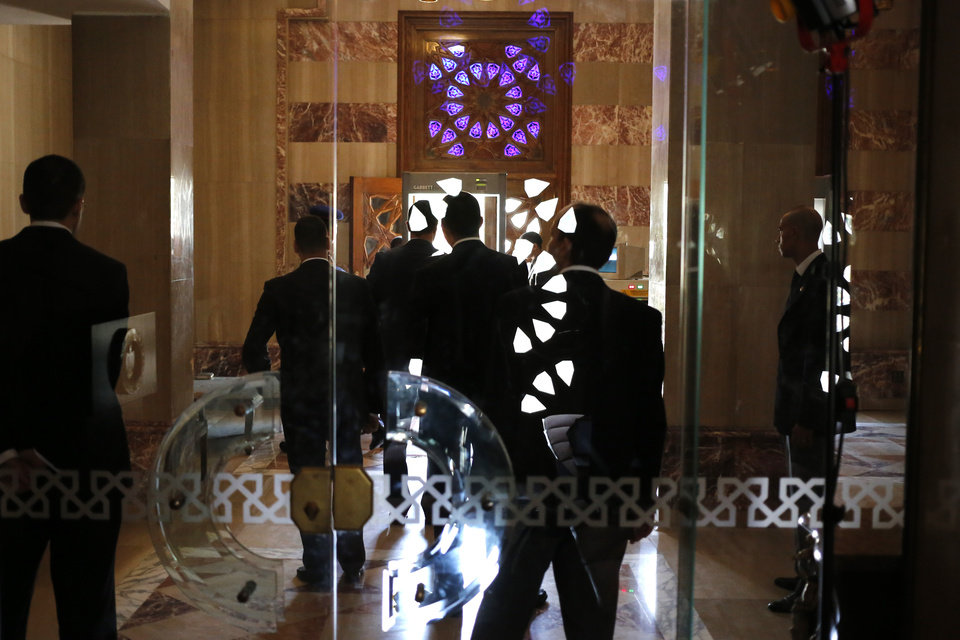 Photo - Egyptian security and officials wait for U.S. Secretary of State John Kerry to arrive for his meeting with Egyptian President Abdel-Fattah el-Sissi at the presidential palace in Cairo, Egypt, Tuesday, July 22, 2014. Kerry is hoping to get international support as he pushes for a Mideast cease-fire, but he acknowledges the differences between Israel and Hamas run very deep and must be addressed in any long-term solution. (AP Photo/Pool)