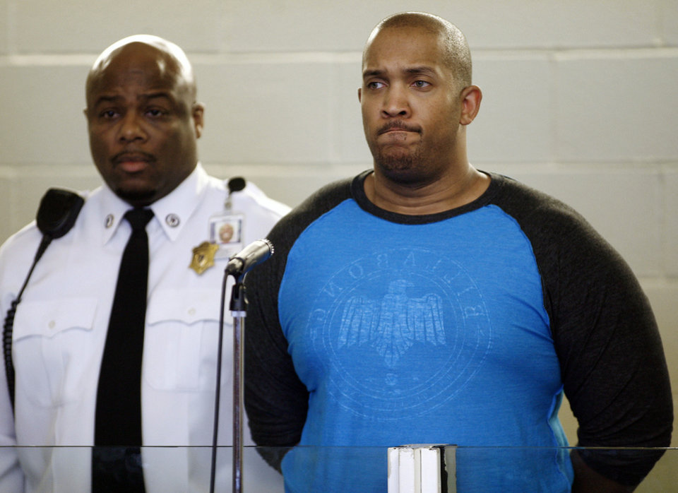 Photo - Gai Scott, of Randolph. Mass., stands during an arraignment, Monday, March 31, 2014, in Plymouth, Mass. Scott was arraigned on charges in the shooting of his uncle and reality TV star Benzino, who was shot Saturday during a funeral procession. (AP Photo/The Patriot Ledger, Greg Derr, Pool)