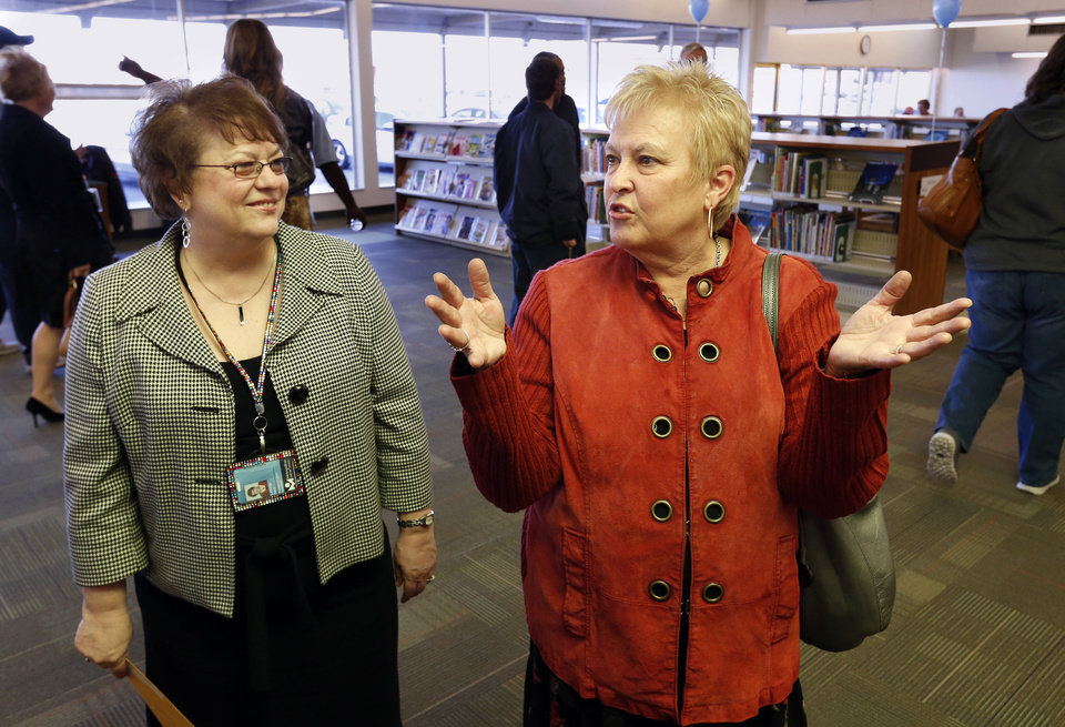 Donna Morris, right, director of the Metropolitan Library System, attends the grand reopening of the Almonte Library.  At left is Almonte  Library Manager LaVetta Dent.  Photo by Steve Sisney, The Oklahoman <strong>STEVE SISNEY - THE OKLAHOMAN</strong>