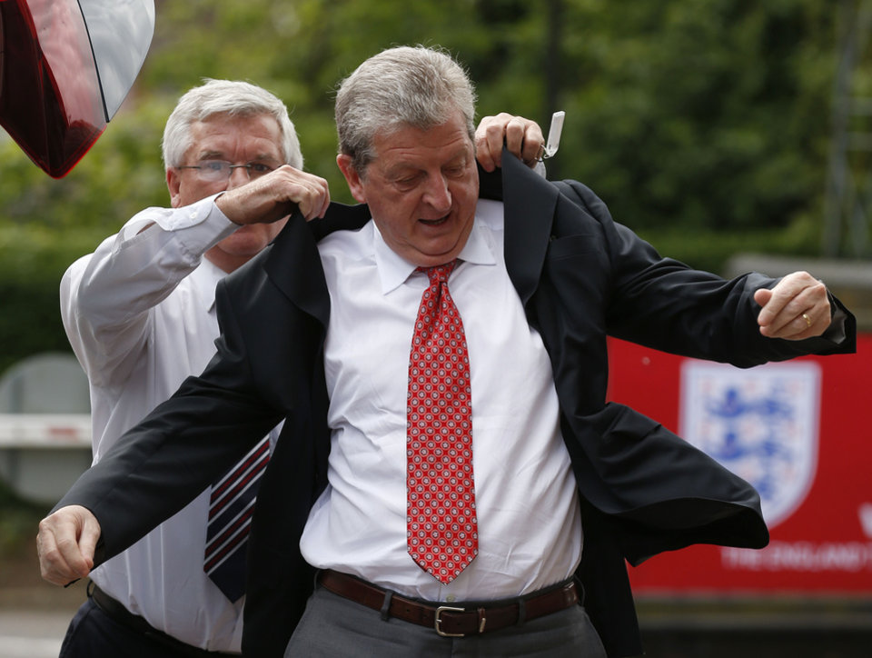 Photo - England's soccer manager Roy Hodgson arrives to announce the national squad for the upcoming World Cup in Brazil, in Luton, England, Monday, May 12, 2014. (AP Photo/Sang Tan)