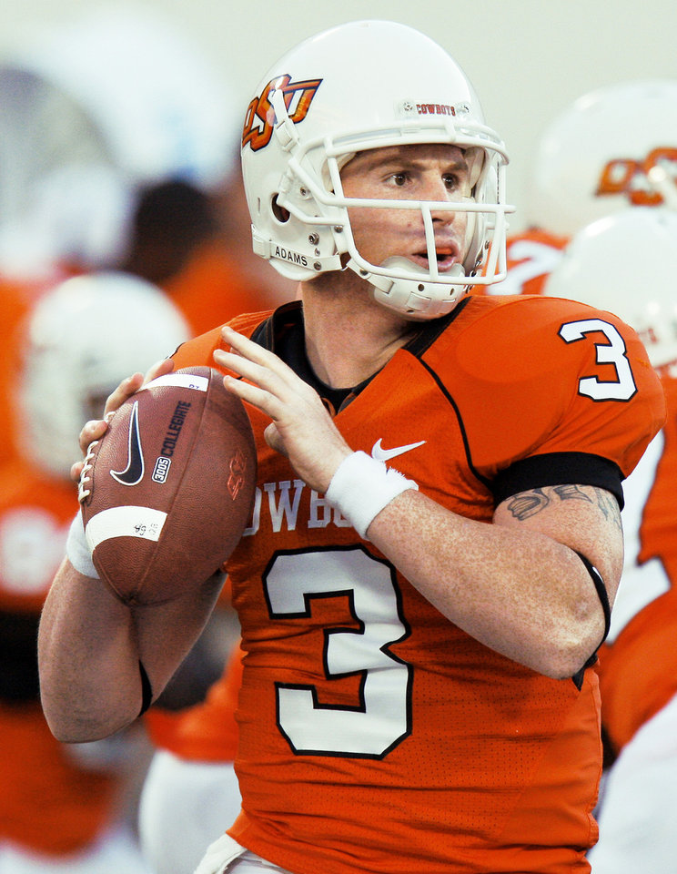 Photo - Alex Cate is battling for the backup quarterback spot with Brandon Weeden.  Photo by Doug Hoke, The Oklahoman