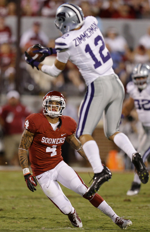 Oklahoma's Kenny Stills (4) watches as Kansas State's Ty Zimmerman (12) intercepts a pass during a college football game between the University of Oklahoma Sooners (OU) and the Kansas State University Wildcats (KSU) at Gaylord Family-Oklahoma Memorial Stadium, Saturday, September 22, 2012. Oklahoma lost 24-19. Photo by Bryan Terry, The Oklahoman