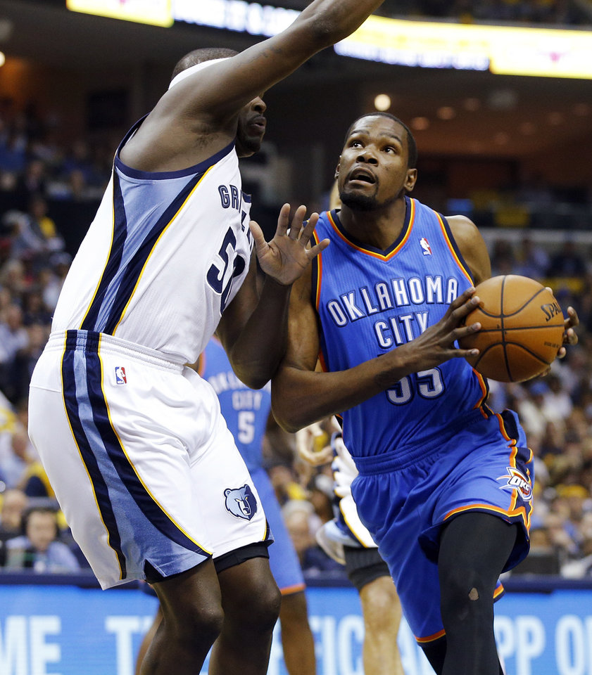 Oklahoma City's Kevin Durant (35) looks to score against Memphis' Zach Randolph (50) during Game 3 in the first round of the NBA playoffs between the Oklahoma City Thunder and the Memphis Grizzlies at FedExForum in Memphis, Tenn., Thursday, April 24, 2014. Photo by Bryan Terry, The Oklahoman