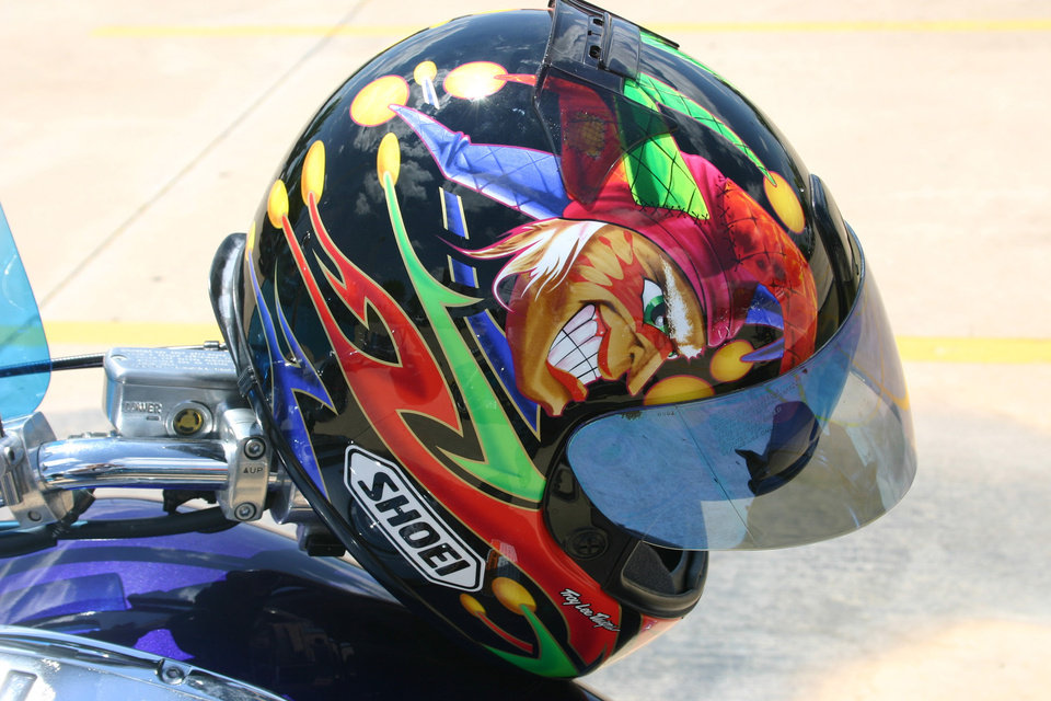 In the biker's world custom artwork isn't limited to motorcycles, but extends to the safety helmets that many bikers wear. This joker's helmet is just an example of the artwork that could be seen during the J. D. McCarty Center Poker Run held Saturday, July 22. The poker run was a 180-mile tour of south central Oklahoma that started at the McCarty Center and ended at the Santa Fe Cattle Company in Norman.<br/><b>Community Photo By:</b> Greg Gaston<br/><b>Submitted By:</b> Greg,