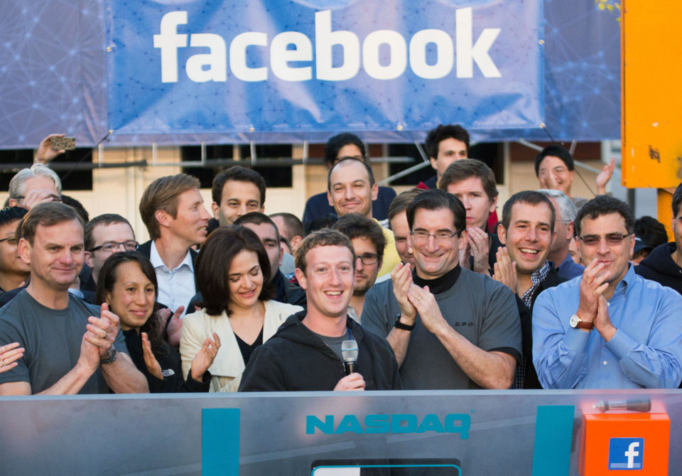 Photo - FILE - In this May 18, 2012 file photo provided by Facebook, Facebook founder, Chairman and CEO Mark Zuckerberg, center, rings the Nasdaq opening bell from Facebook headquarters in Menlo Park, Calif. Robert Greifeld, second from right, CEO of the Nasdaq-OMX Stock Market, Inc., said Sunday, May 20, the stock exchange is