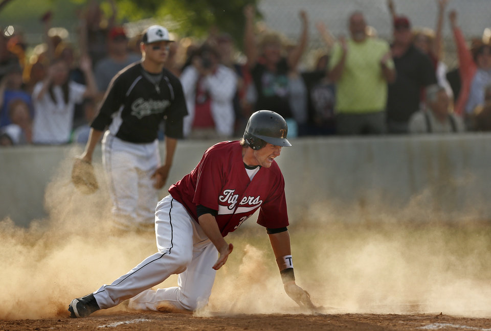 Photo - Tuttle's Dalton Secrist celebrates his run during the class 4A baseball game between Catoosa and Tuttle at Edmond Santa Fe High School in Edmond, Okla., Friday, May 16, 2014. Photo by Sarah Phipps, The Oklahoman